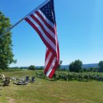 Flag hanging nearby the vineyards